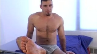Restrained muscular hunk receives foot kittling in 3way